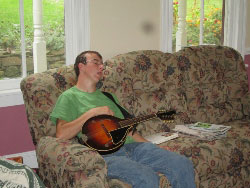 Luke asleep instead of playing mandolin